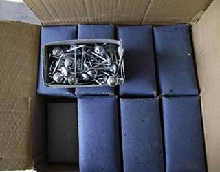 8 boxes of galvanized roofing nails in a carton